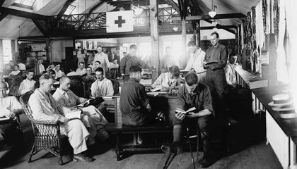 United States World War I soldiers reading in the War Library Service section of the Red Cross building at Walter Reed Hospital.