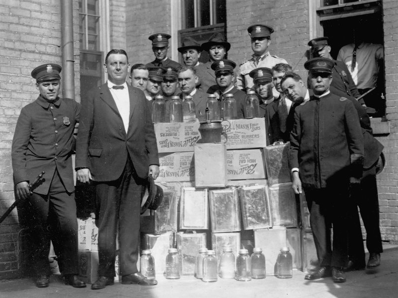 Police Officers With Confiscated Moonshine