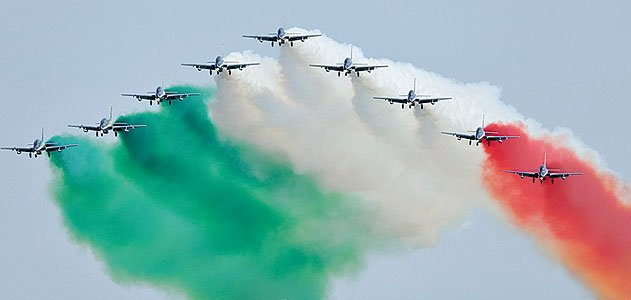 """<i>Ciao!</i> Italy's military precision jet team, Frecce Tricolori (""""Tricolor Arrows""""), makes its first visit to North America with performances on August 2 and 3 at the Experimental Aircraft Association's 34th Fly-in Convention in Oshkosh, Wisconsin. The"""