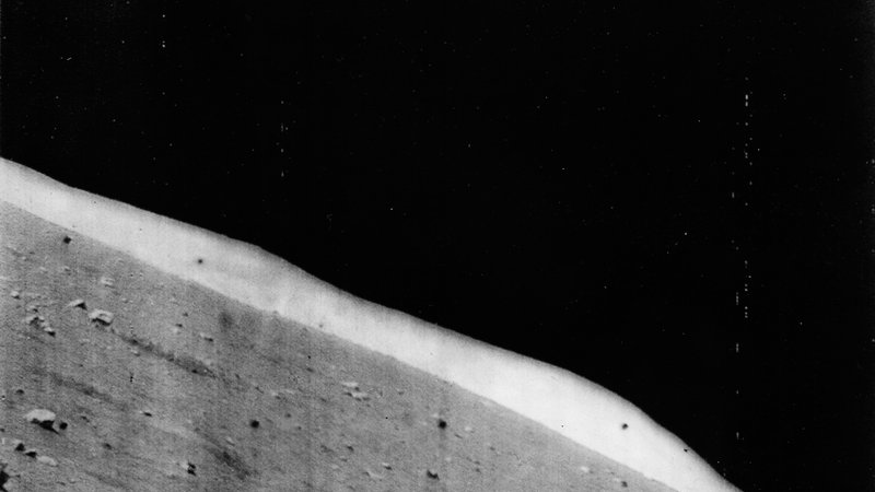 Horizon view taken from the Surveyor 1 spacecraft looking north. The hills in the distance make up the rim of Flamsteed P.