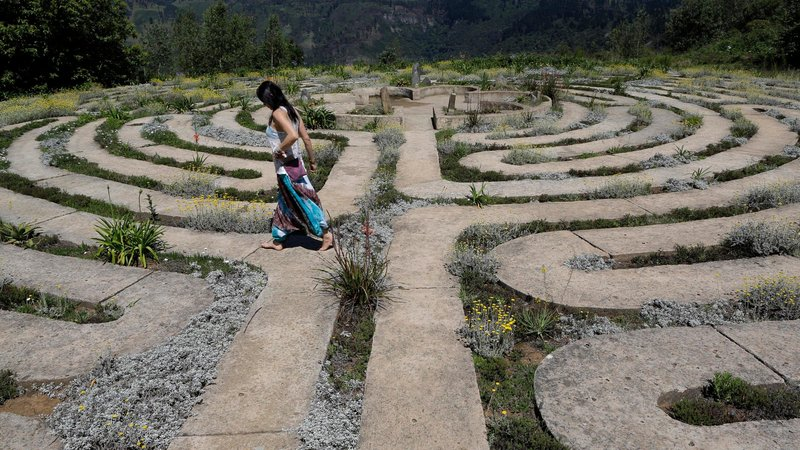 A tourist walking through one of the biggest labyrinths in South Africa, in Hogsback. The tiny town is famous for its spiritual activities and has crystal healers, yogis, hippies and the like living in the mountaintop town.