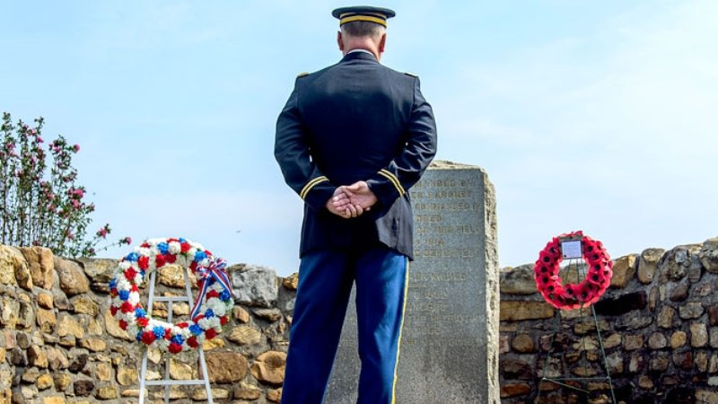 Attend a formal military ceremony honoring fallen American and British soldiers with the dedication of a new monument