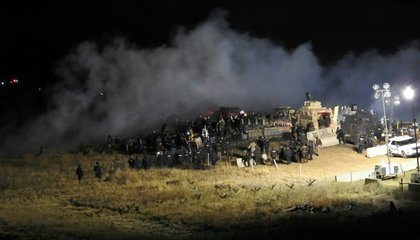 Police Spray Dakota Access Pipeline Protesters With Water and Tear Gas in Freezing Temperatures