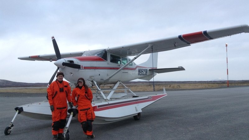 Chris Dau, a retired FWS pilot-biologist, and Wilson wear the coast-guard style immersion suits as they prepare for a long water crossing during one of the last winter waterfowl surveys of the year.
