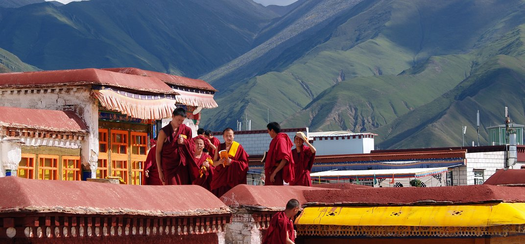 Monks amid the mountain landscape of Tibet