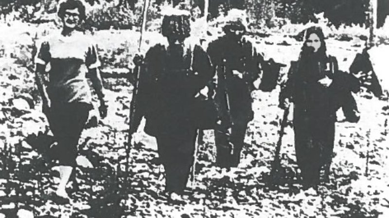 A Russian press photo of Karp Lykov (second left) with Dmitry and Agafia, accompanied by a Soviet geologist.
