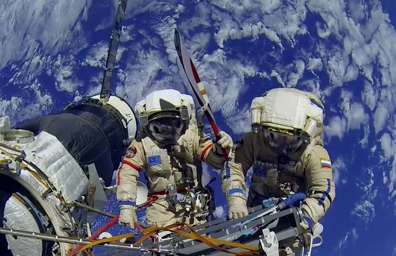 Olympic-torch-Nov 13 spacewalk.jpg
