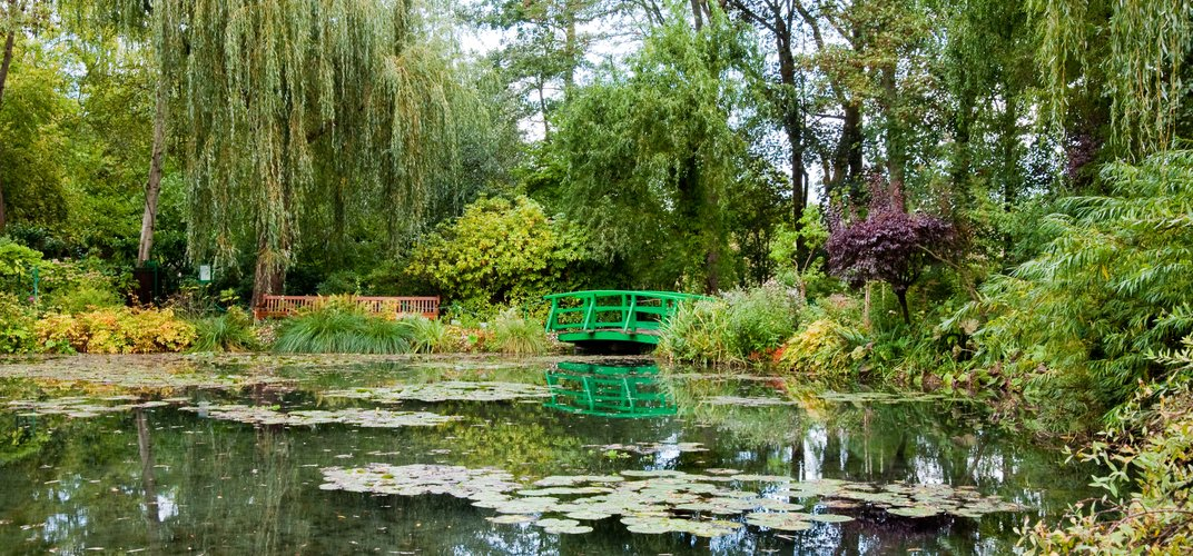 The famous lily pads and green bridge at Giverny used as inspiration for Monet