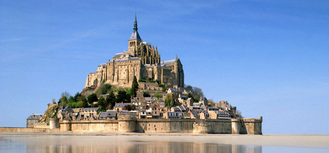 The iconic Mont St. Michel, off the coast of Normandy.  Credit: nagelstock.com/Alamy