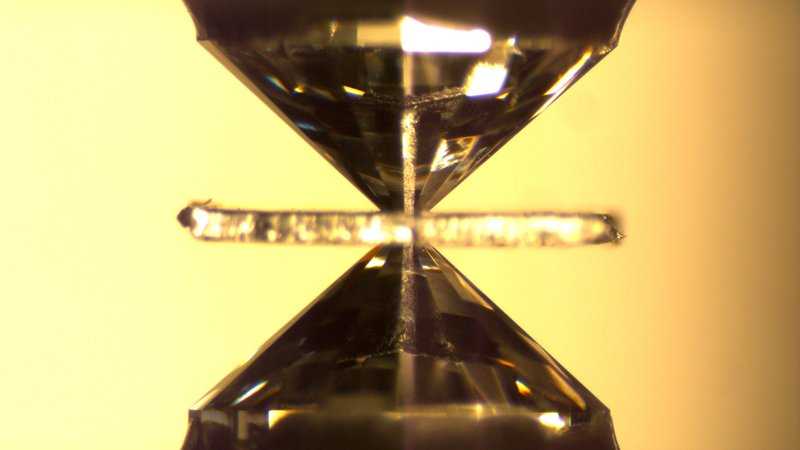 A diamond-anvil cell is used to simulate conditions deep inside the Earth, squeezing samples using enormous pressures.