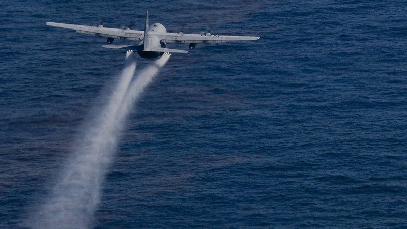 A U.S. Air Force jet drops dispersant onto the Gulf oil slick. Dispersant was also applied in the deep sea at the source of the leak.