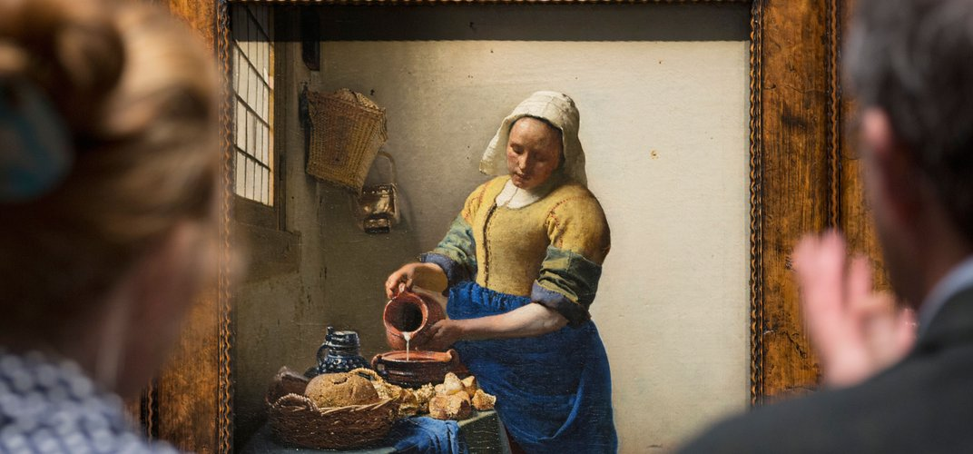 Vermeer's <i>The Milkmaid</i> in Amsterdam's Rijksmuseum. Credit: Frans Lemmens/Alamy