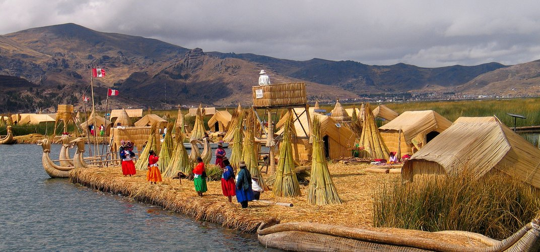 Uros women standing on a reed island on Lake Titicaca