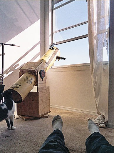 Still life with telescope, feline, and feet. Even the National Air and Space Museum uses a Dobsonian telescope to show visitors the sun.