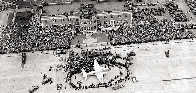 On July 14, 1938, thousands gathered for the return of Howard Hughes, who in four days had flown a Lockheed Super Electra around the world.