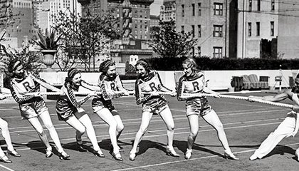 Charles Atlas tug of war with Rockettes