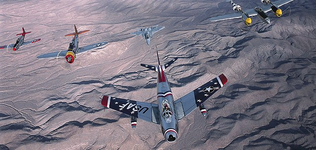 At the 2002 Nellis Air Show near Las Vegas, a Sabre heads up an A team in a USAF Heritage Flight: (from left) P-51 Mustang, P-47 Thunderbolt, F-15 Eagle, P-38 Lightning, and TF-51.