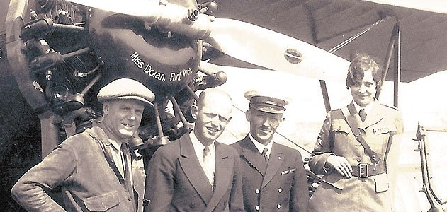 Left to right: Bill Malloska, the airplane's owner; Augie Pedlar, pilot; Manley Lawling, navigator, later replaced by Vilas Knope; and Mildred Doran, in classic uniform.