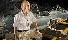 Museum volunteer Tom Momiyama with the last remaining Ohka K2 at the Museum's restoration facility.