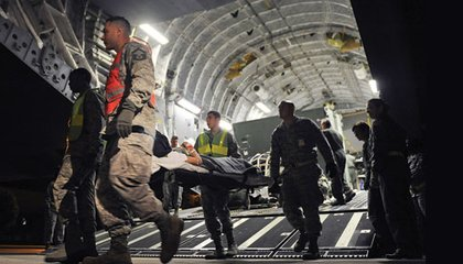 Wounded service members are taken off a C-17