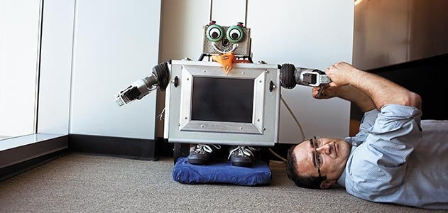Javier Movellan with robot