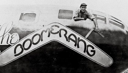 Carl Schahrer, commander of the B-29 Boomerang, shows off the talisman, on which his crew carved their missions.