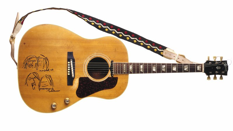 "John Lennon originally acquired this guitar in 1964 to replace an identical one that was stolen. He used it extensively throughout his career. It was prominently seen in the film Help! In 1967, the guitar was painted psychedelic blue and red by the Fool, the Dutch art cooperative that also painted Lennon's Rolls-Royce. In 1968, Lennon had the guitar's finish stripped to the natural wood finish. Lennon and Yoko Ono held two ""bed-ins"" for peace in March and May of 1969, which Lennon commemorated by drawing caricatures of Yoko and himself on the guitar. It was during the second bed-in, held at the Queen Elizabeth Hotel in Montreal, that the single ""Give Peace a Chance"" was recorded, using this guitar."