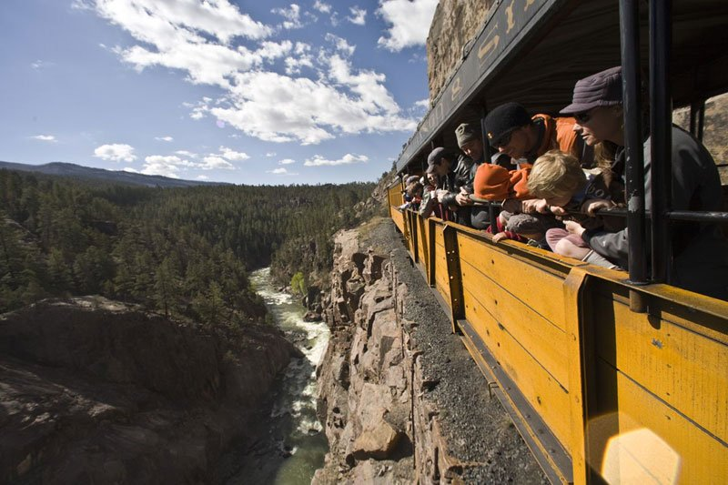 The narrow-gauge Durango & Silverton train steams through history above the Animas River.
