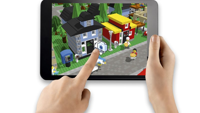 Kids build houses out of Lego bricks in real life, then customize their Sim City–like town in the app.
