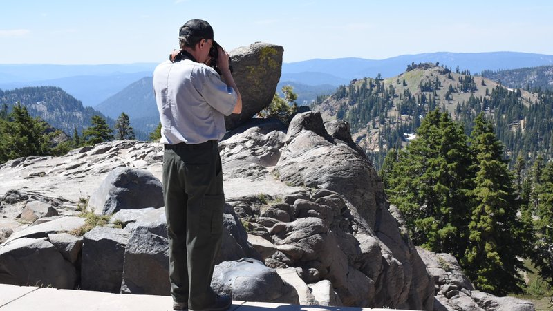 Michael Magnuson surveys the land for pikas in Northern California's Lassen Volcanic National Park, which is bracing itself for changes.
