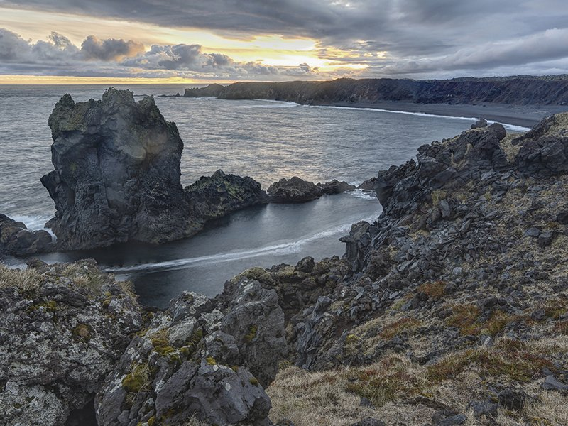 In Iceland, at one end of the 10,000-mile-long Mid-Atlantic Ridge, a visitor could see new crust being born as magma oozes up from the interior.
