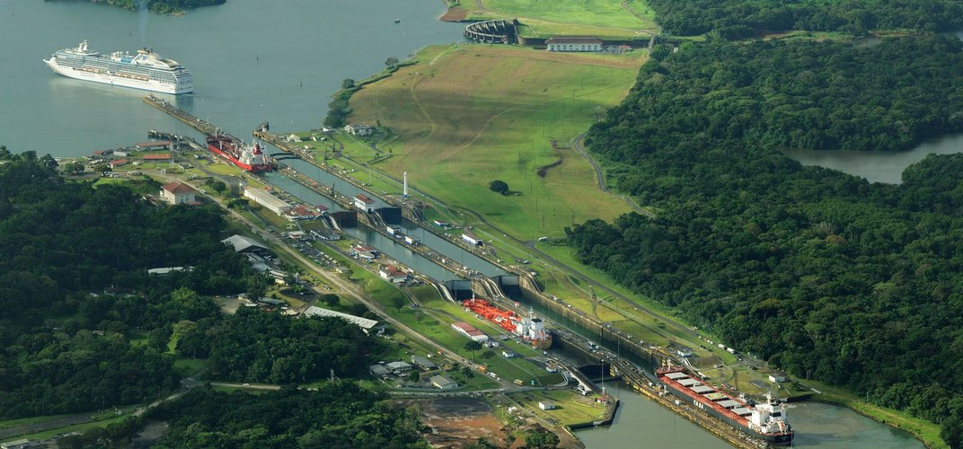 Ships moving through a lock in the Panama Canal. Credit: Hemis/Alamy