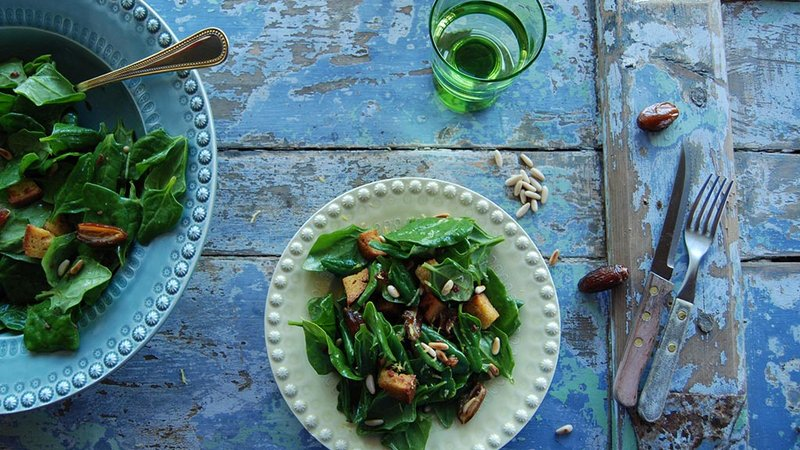 Spinach salad with dates, pine nuts and cornbread.