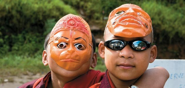 young monks at a religious festival sport trendy shades, masks