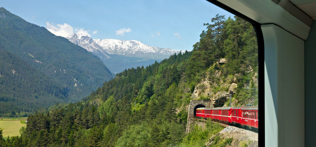 The <i>Glacier Express</i> traveling through a tunnel in the Alps