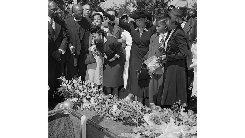 Mamie Till Mobley mourns over her son's casket.