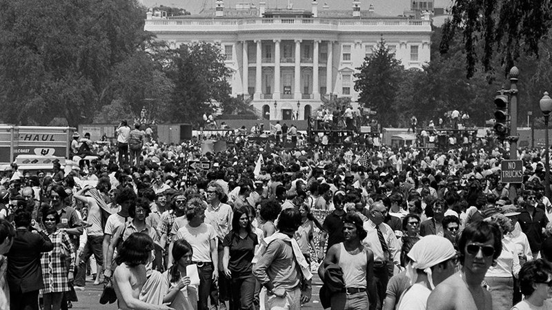 Anti-war demonstrators raise their hands toward the White House as they protest the shootings at Kent State University and the U.S. incursion into Cambodia, on May 9, 1970.