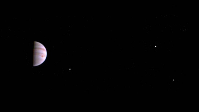 Jupiter and its moons Io, Europa and Ganymede as photographed by the Juno mission shortly after the spacecraft entered orbit around the gas giant.