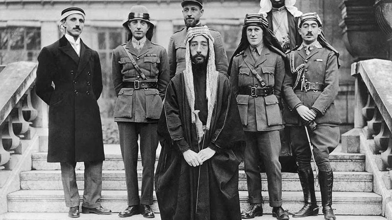 Emir Hussein's son Faisal at the Versailles peace conference in 1919 with his delegates and advisors: (left to right) his private secretary and fellow delegate Rustem Haidar, Brigadier General Nuri Said of Baghdad, Captain Pisani of France, Col. T. E. Lawrence, and Hassan Kadri.