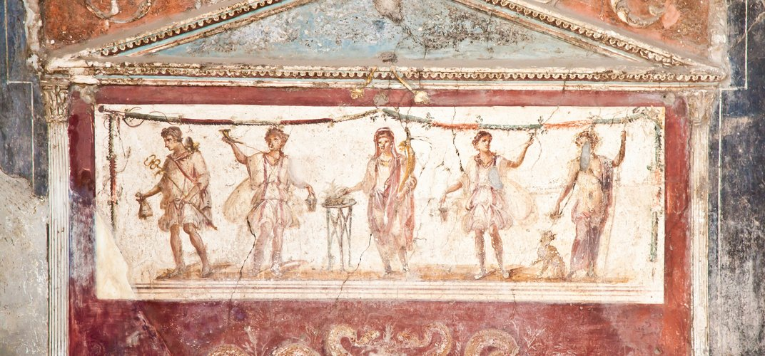 Detail of a painted wall in a house in Pompeii