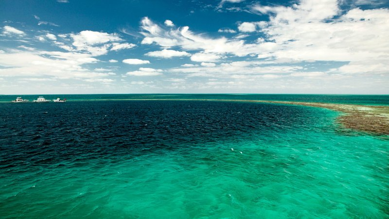 Entrance to the famous Great Blue Hole. In the center of the Lighthouse Reef, part of the Belize Barrier Reef Reserve System, and a World Heritage Site.