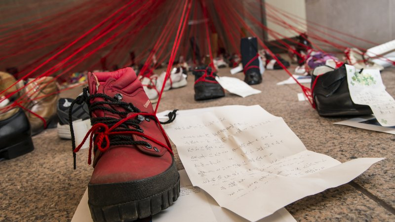 Each shoe in Chiharu Shiota's installation at the Arthur M. Sackler Gallery is attached to a handwritten note about its owner.
