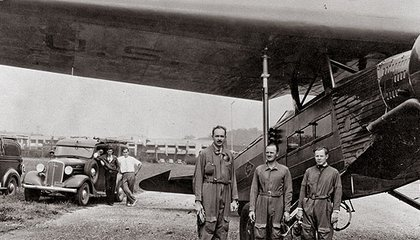 Captain Carl Crane, who invented the autoland system, Captain George Holloman, and engineer Raymond Stout