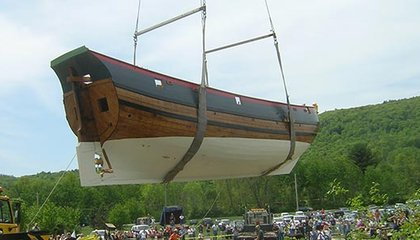 The Onrust being placed in the Hudson River