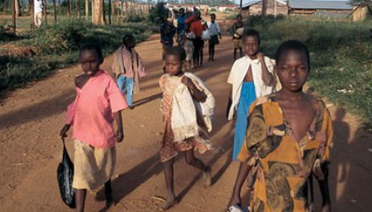 children by the thousands leave their huts to trek to safe havens